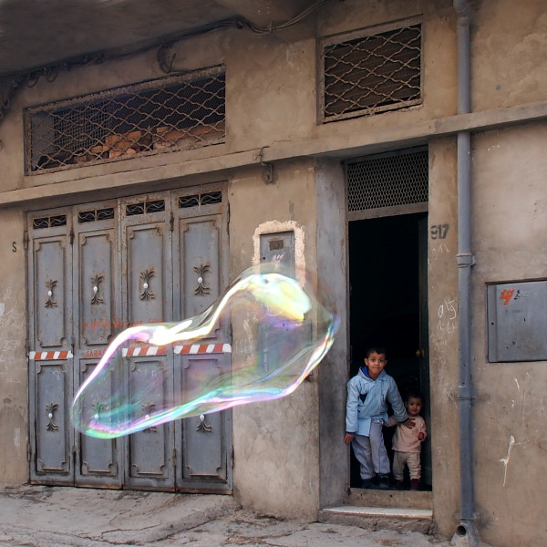 "Photograph by Khaled Youssef from his series, ""Make Bubbles Not War"""